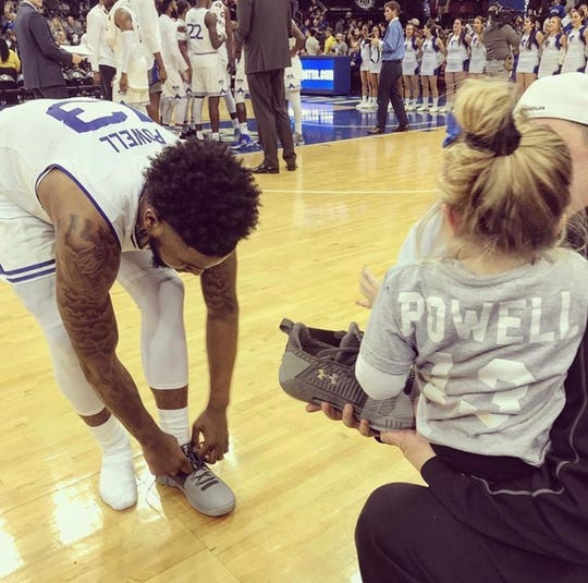 Myles Powell gives his sneakers to a young fan after a 2019 game at the Prudential Center