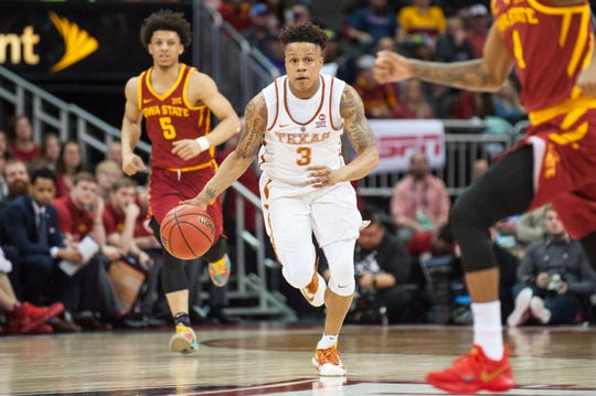 Jacob Young (3) moves the ball up the court for Texas in 2018.