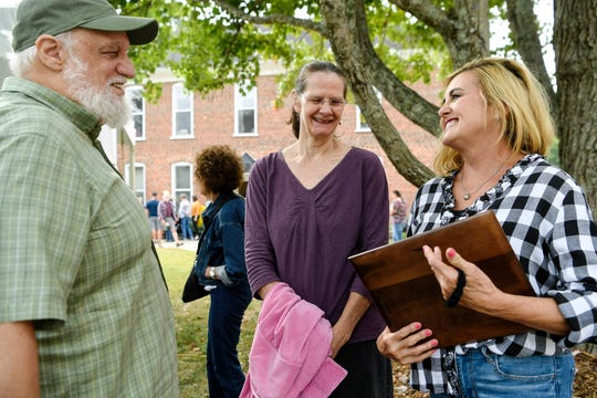 "Loretta Freeman, right, talks to friends Don and Jean Pedi as she holds her Bascom Lamar Lunsford Award during the annual Bascom Lamar Lunsford ""Minstrel of Appalachia"" Festival on the campus of Mars Hill University October 5, 2019."