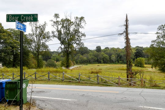 A Charlotte developer plans to build an 802 unit development of apartments and homes near West Asheville, stirring concerns from neighbors.