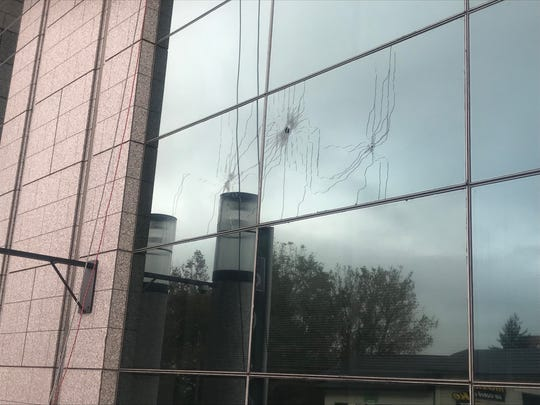 Bullet holes were visible in the Veach-Baley Federal Building after an Oct. 5 shooting downtown.