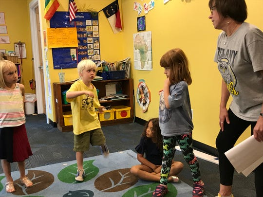 Kelley Johnson guides kindergarten students at Francine Delany in an activity about their bodies.