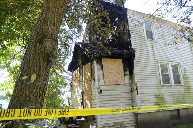 Firefighters said a fire Sunday night at 66 Wilkes St. was started at the back of the house.