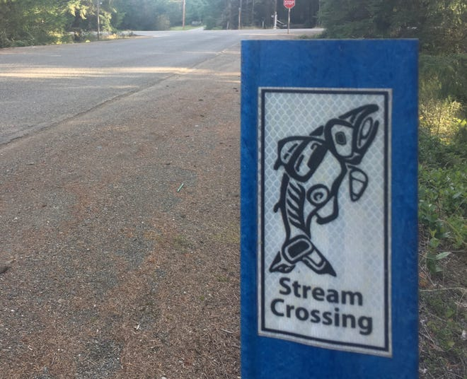 A sign on Wicks Lake Road indicates the stream that flows through a culvert below  is a fish-bearing stream