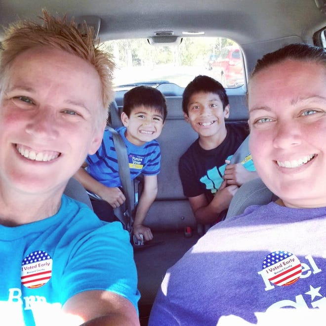 Paula and Stephanie Steen adopted two  children of Hispanic descent. They worry about President Trump's anti-immigrant rhetoric.