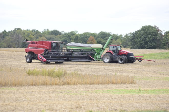 A combine in Crawford County sits ready to finish harvesting soybeans Monday morning. Sunday's rains paused work in many fields.