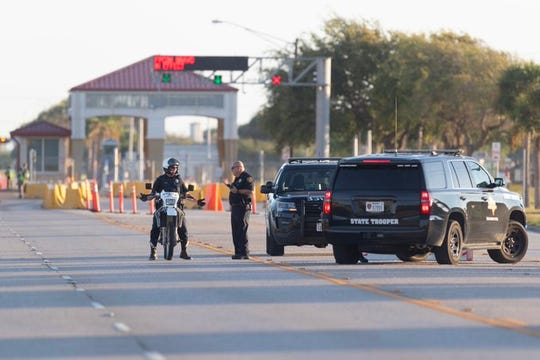 Law enforcement stands guard outside one of the gates at Naval Air Station-Corpus Christi on Monday, Oct. 7, 2019, after a suspect was taken into custody. The incident prompted the base and nearby Texas A&M University-Corpus Christi to go on lockdown.