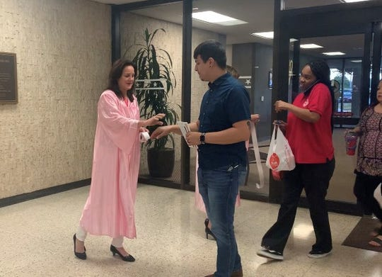 October is Breast Cancer Awareness month, and State District Judge Missy Medary (left) began the tradition of wearing a pink robe and encouraging women to get mammograms 10 years ago. Now other judges participate as well.