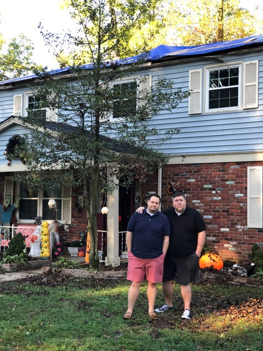 Ron (left) and Mike Gallo stand outside their Cherry Hill home. Their family was displaced from their home after a tree crashed through their roof during a Sept. 28 storm.