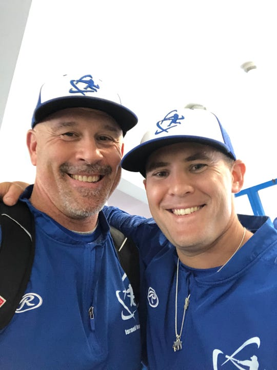 Cherry Hill East graduate Nate Mulberg, right, an assistant coach with Team Israel baseball, stands next to manager Eric Holtz after the team qualified for the Olympics in September