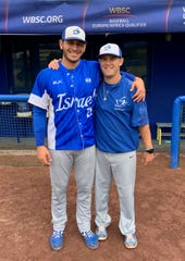 Cherry Hill East graduate Nate Mulberg, right, stands with Jon de Marte after Team Israel qualified for the Olympics in September. Mulberg recommended de Marte for the team, and de Marte recommended Mulberg to join as an assistant coach during the European Championships.