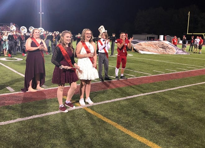 OCT 4, 2019 MILFORD HIGH SCHOOL, MILFORD, OHIO: Trinity Miller and Abigail Stropes are honored at midfield Friday, Oct. 4 at as Milford High School's homecoming Royalty honorees as selected by their peers. The Ohio high school has done away with the gender roles of homecoming king and queen forever so that any two students can be elected to the two Homecoming Royalty spots.