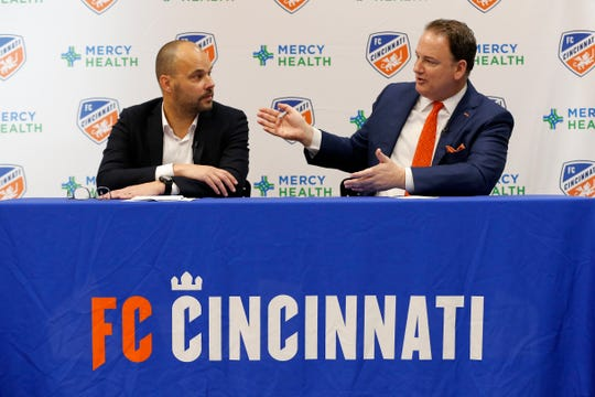 FC Cincinnati president Jeff Berding describes the hiring process during a press conference to introduce the team's new general manager at the FC Cincinnati practice facility in Milford, Ohio, on Thursday, May 30, 2019. FC Cincinnati announced team president Jeff Berding would be stepping away from soccer operations to make way for the new GM.