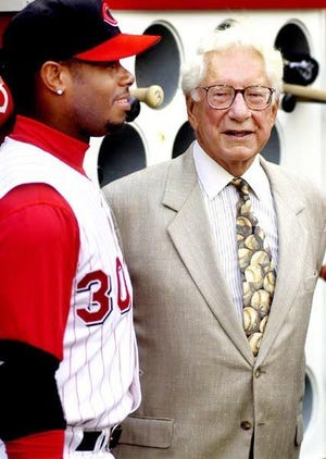 The late Carl H. Lindner Jr., right, with Ken Griffey Jr. when Lindner owned the Reds.