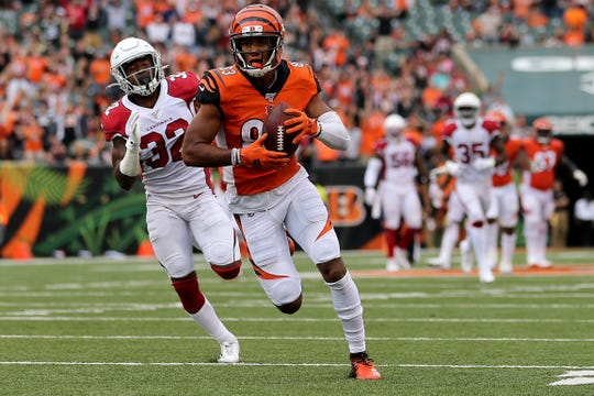 Cincinnati Bengals wide receiver Tyler Boyd (83) runs downfield after completing a catch in the fourth quarter of an Week 5 NFL football game against the Arizona Cardinalsa, Sunday, Oct. 6, 2019, at Paul Brown Stadium in Cincinnati. The Arizona Cardinals won 26-23.