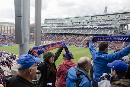 FC Cincinnati fans march to the Bailey  before the MLS match between FC Cincinnati and Portland Timbers on Sunday, March 17, 2019, at Nippert Stadium in Cincinnati.