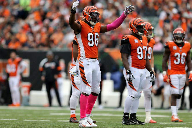 Cincinnati Bengals defensive end Carlos Dunlap (96) pumps up the crowd in the third quarter of an Week 5 NFL football game against the Arizona Cardinals, Sunday, Oct. 6, 2019, at Paul Brown Stadium in Cincinnati. The Arizona Cardinals won 26-23.