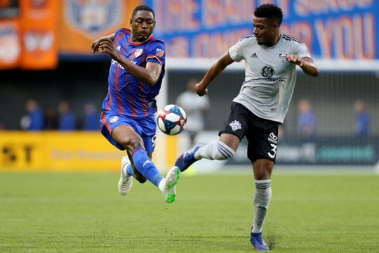 FC Cincinnati forward Fanendo Adi (9) sprints for the ball as Louisville City FC defender Alexis Souahy (3) defends in the first half of a US Open Cup match, Wednesday, June 12, 2019, at Nippert Stadium in Cincinnati.