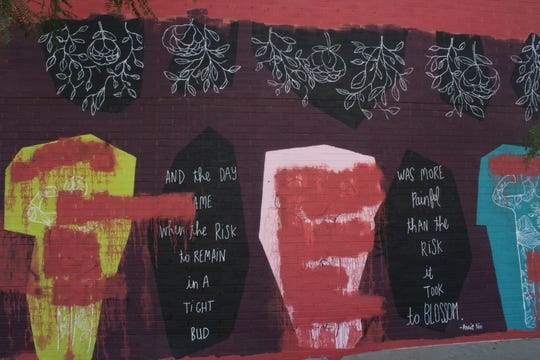 The mural created by an Iowa artist, Kelsey Lampe, was inspired by  Marsy's Law, a law that guarantees victims the same rights defendants.