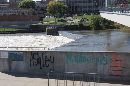 Vandalism similar to the defacement of an East Village mural was found on the Women's Achievement Bridge.