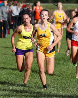 Jacie Mitchell competes in the Rams Invitational on Oct. 3 at Southeast Polk High School. Waukee won the girls' race and Ames won the boys' race.