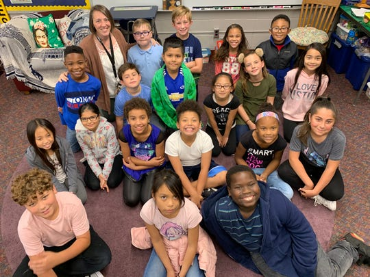 Sarah Flores with her fourth-graders at Morris Elementary in Des Moines.
