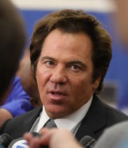Detroit Pistons owner Tom Gores answers questions at the new Henry Ford Health System Detroit Pistons Performance Center in Detroit, Monday, Oct. 7, 2019.