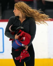 An ice crew member picks up hats after Anthony Mantha scored his third goal vs. the Stars.