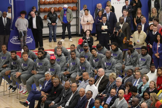 Pistons players listen to speeches during the opening of the new Henry Ford Health System Detroit Pistons Performance Center in Detroit, Monday, Oct. 7, 2019.