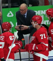 Detroit Red Wings head coach Jeff Blashill talks to players, as Dylan Larkin (71) listens during action against the Dallas Stars, Sunday, Oct. 6, 2019 at Little Caesars Arena.