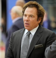 Tom Gores answers questions at the new Pistons Performance Center in Detroit, Oct. 7.