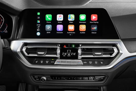 BMW charges $80 a year or a flat fee of $300 for Apple CarPlay, a connectivity feature many automakers offer as standard equipment.