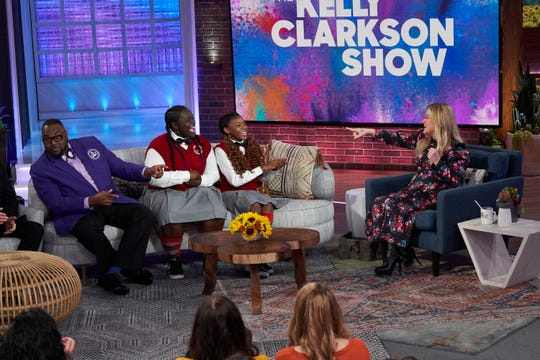 From left: Detroit Youth Choir director Anthony White and choir members talk to Kelly Clarkson on her new daytime talk show.