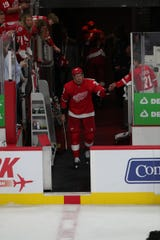 Anthony Mantha high-fives a Detroit Red Wings fan Sunday, Oct. 6, 2019 at Little Caesars Arena.