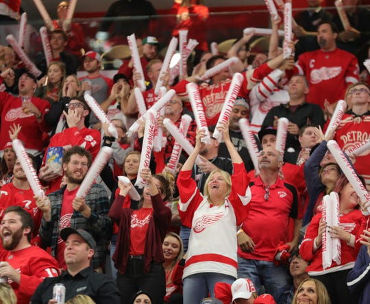 Red Wings fans celebrate a goal against the Stars during the second period Sunday at Little Caesars Arena.