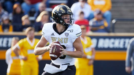 Western Michigan quarterback Jon Wassink looks for a receiver in the game against Toledo.