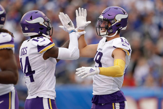 Minnesota Vikings wide receiver Adam Thielen (19) and Minnesota Vikings wide receiver Stefon Diggs (14) celebrate after a touchdown against the New York Giants during the third quarter.