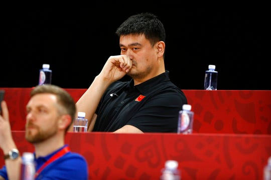 In this Sept. 4, 2019, file photo, Yao Ming, head of the Chinese Basketball Association and former NBA player, watches as China and Venezeula compete. Yao is now president of the Chinese Basketball Association, which announced over the weekend it is suspending its ties with the Rockets in retaliation for Houston Rockets general manager Daryl Morey's tweet that showed support for Hong Kong anti-government protesters.