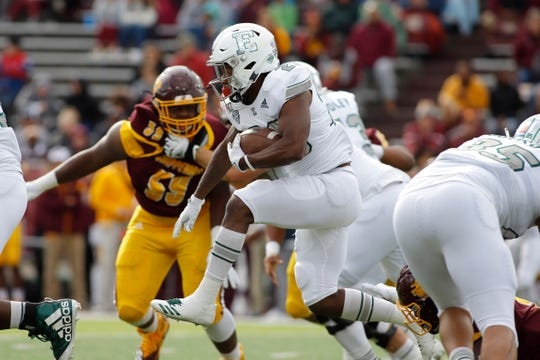 Eastern Michigan's Willie Parker rushes against Central Michigan on Saturday.