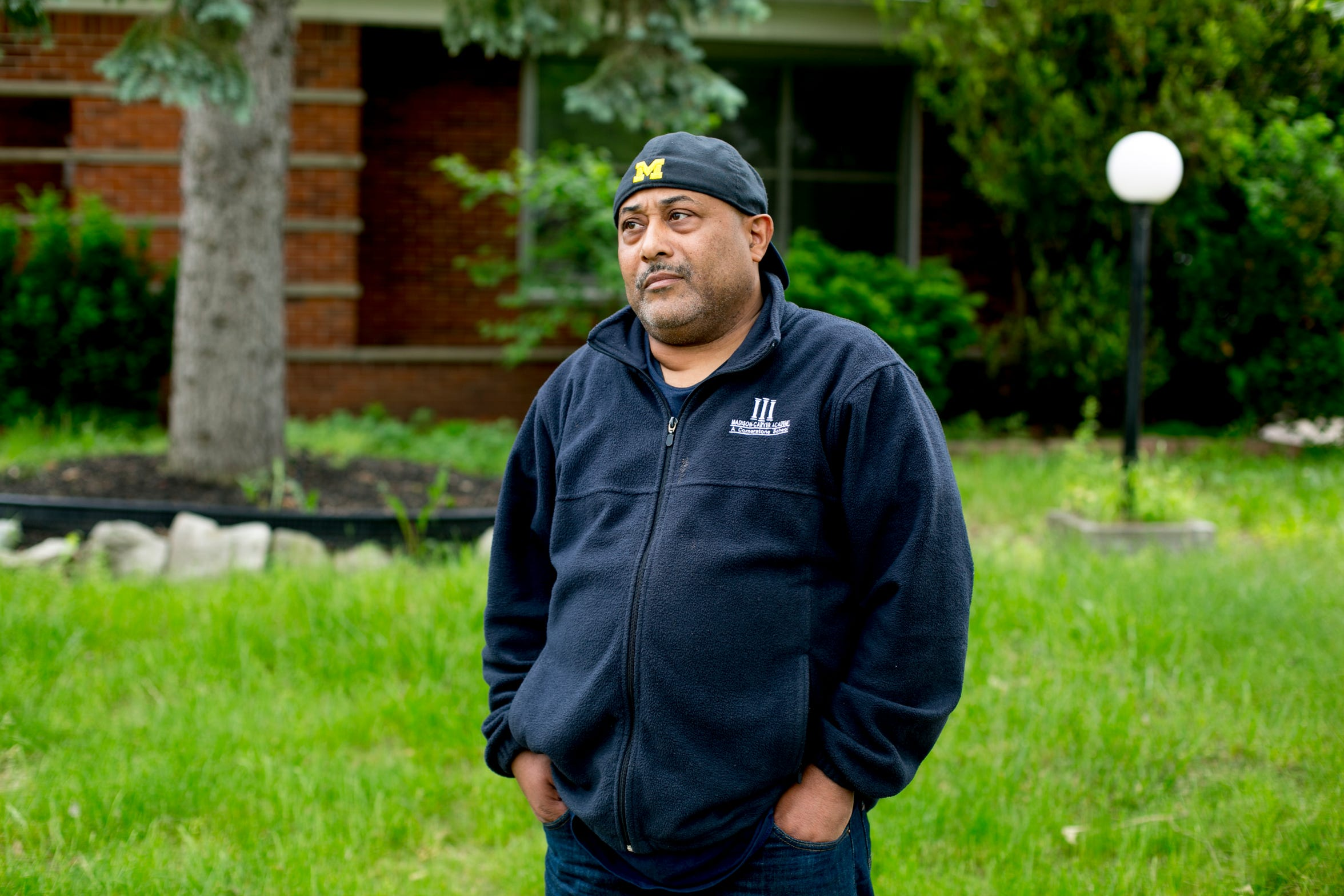 Roderick Randolph stands outside his home on the far west side of Detroit. He  has been struggling to pay off unpaid property taxes he accumulated during a period of unemployment.