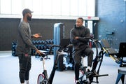 Detroit Pistons Markieff Morris, left, and Tim Frazier check out the new weight room inside the Detroit Pistons Performance Center in Detroit.