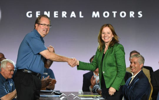 General Motors Co. CEO Mary Barra shakes hands with United Auto Workers President Gary Jones at the start of national contract talks in July.