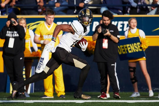 Western Michigan wide receiver Jaylen Hall runs after he makes a reception against Toledo.