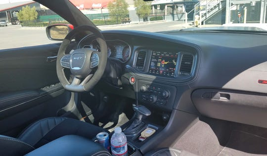 The interior of the 2020 Dodge Charger Widebody Hellcat features stitched leather and some of the finest infotainment solutions in autodom.