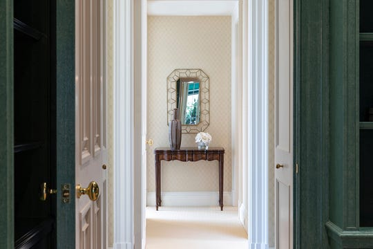 A mirror at the end of a hallway creates a visual focus.