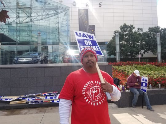 "Daniel Rider, 56, of West Lake, a machinist at GM's Romulus engine plant, says he expects a ""fair and just"" agreement while picketing outside the Renaissance Center in Detroit, the Detroit automaker's headquarters."