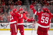 From left, Detroit center Dylan Larkin, right wing Anthony Mantha and the rest of the Red Wings celebrate Mantha's fourth goal of the game in the third period.