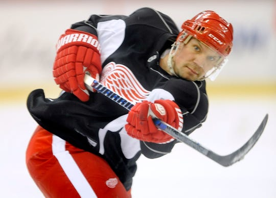 Red Wings captain Nicklas Lidstrom takes a shot during practice at Joe Louis Arena in 2010.