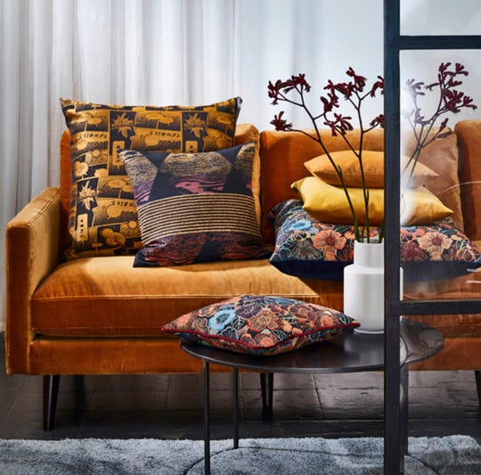 The richness of an autumn palette is dynamic with one of those 'tween colors -- Orange? Dark butterscotch? Saffron? The velvet sofa from the German brand Apelt is teamed with printed velvet pillows that introduce black, salmon, pinks and blues.
