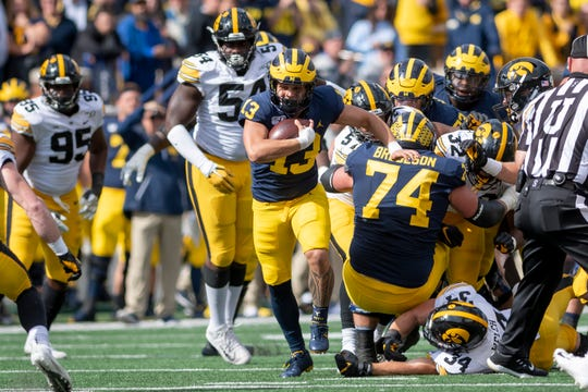 Michigan running back Tru Wilson rushed for 28 yards on four carries last week against Iowa, contributing to the Wolverines' 120 yards on the ground against the Hawkeyes.